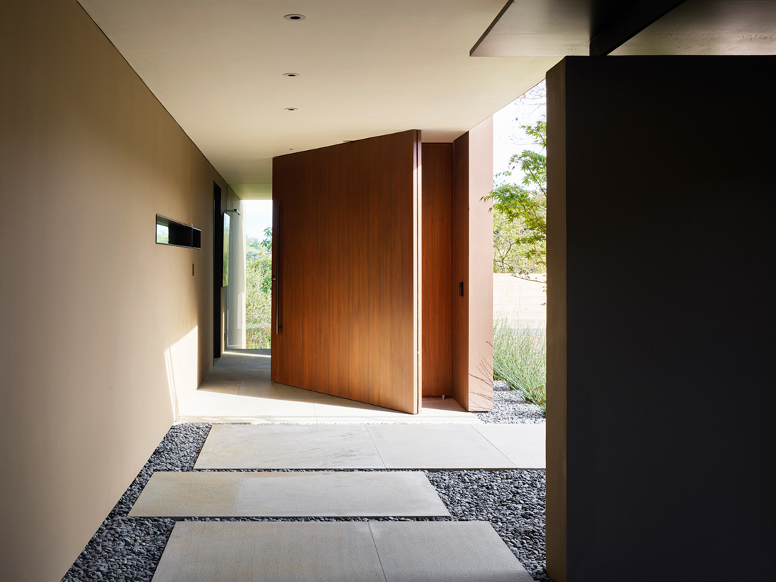 The impressive, outsize mahogany front door is a conversation-starter.