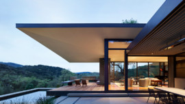 The siting of the house on a slope in the Santa Lucia Preserve maximizes the views and privacy.